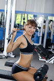 Caucasian Woman on training apparatus in club Stock Image