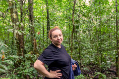 Caucasian Woman Traveling Deep In The Cuyabeno Jungle. Young Caucasian Woman With Rain Coat Traveling Along Amazonian Jungle, Cuyabeno National Park, South stock photography