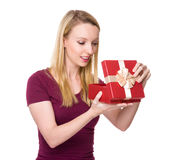 Caucasian woman unwrap of gift box Royalty Free Stock Photos