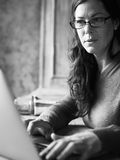 Caucasian woman using computer laptop grayscale Royalty Free Stock Image