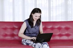 Caucasian woman using laptop computer at home.  Royalty Free Stock Image