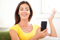 Caucasian woman using a mobile phone Stock Images