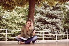 Caucasian woman using mobile phone outdoor. stock photos