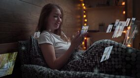 Caucasian woman using a smartphone sitting in a bed. Visual contents concept.