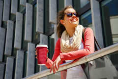 Caucasian woman Vivacious in City with a beautiful beaming smile. Backlit by the warm glow of the sun shining down City Royalty Free Stock Image