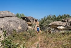 Caucasian Woman Walking Among Natural Sandstone Formations Royalty Free Stock Photos