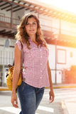 Caucasian woman walking with confidence outdoors Royalty Free Stock Photo
