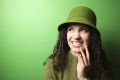 Caucasian woman wearing green clothing and hat. Smiling young Caucasian woman on green background wearing green clothing and hat Royalty Free Stock Photos