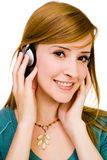 Caucasian woman wearing headphones Royalty Free Stock Images