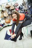 Caucasian woman wearing rubber boots in shop Stock Images