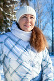 Caucasian woman in winter clothes at sunny day, portrait Royalty Free Stock Images