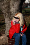 Caucasian woman wit sunglasses looking on autumn background Royalty Free Stock Photography