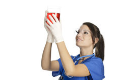 Caucasian woman working as a laboratory technician studing a beaker Royalty Free Stock Photo