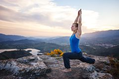 Caucasian woman working out on a rock Royalty Free Stock Images