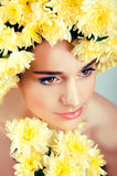 Caucasian woman with yellow flowers wreath around her head Royalty Free Stock Photo