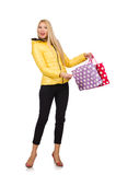 Caucasian woman in yellow jacket holding plastic bags isolated o Royalty Free Stock Photography
