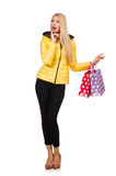 Caucasian woman in yellow jacket holding plastic bags isolated o Stock Photography