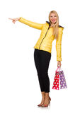 Caucasian woman in yellow jacket holding plastic bags isolated o Stock Photos
