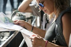 Caucasian woman checking using Bangkok Thailand map. Caucasian women checking using Bangkok Thailand map stock photo