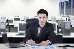 Caucasian worker in the workplace Stock Images