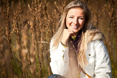 Caucasian young adult blond woman outdoor fall tim Royalty Free Stock Photography