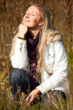 Caucasian young adult blond woman outdoor fall tim Royalty Free Stock Photo