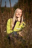 Caucasian young adult blond woman outdoor fall tim Stock Photos