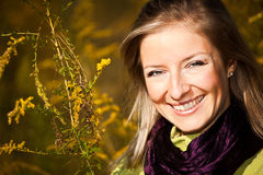Caucasian young adult blond woman outdoor fall tim Royalty Free Stock Photos