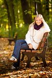 Caucasian young adult blond woman outdoor fall tim Royalty Free Stock Image