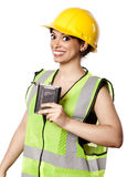 Alcohol Safety Woman. Caucasian young adult woman in her mid 20's wearing reflective yellow safety helmet and safety vest, holding a hip flask and looking at the Royalty Free Stock Photography