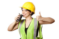 Alcohol Safety Woman Thumbs Up. Caucasian young adult woman in her mid 20's wearing reflective yellow safety helmet and safety vest, just about to take a sip Stock Images