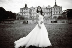 Caucasian young bride next to castle in west Ukraine Royalty Free Stock Photos