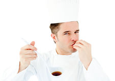 Caucasian young cook tasting a delicious soup Royalty Free Stock Photos