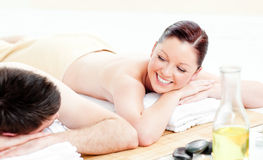 Caucasian young couple receiving a back massage Royalty Free Stock Images