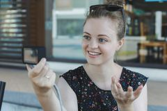 A caucasian young girl making a video blog vlog or a photo holding small camera. Close up royalty free stock photos
