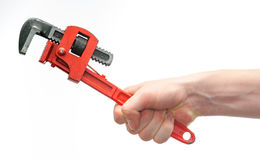 Caucasian young hand gripping a wrench Royalty Free Stock Images