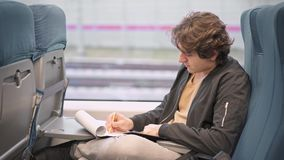 Man writing on his way to work stock footage