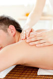 Caucasian young man enjoying a back massage Stock Photo
