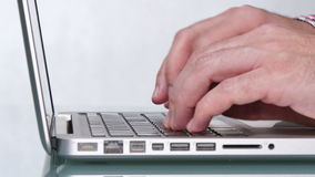 Caucasian Young Man Typing on his Laptop. Writer writes his last novel. Businessman writing on his personal computer. Employee sending an email in the office stock video