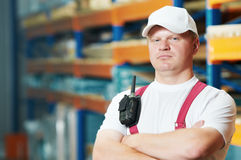 Caucasian young manual worker in warehouse Stock Photos