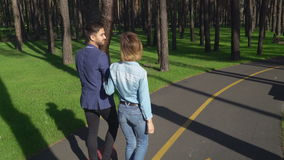 Caucasian young people enjoy dating in the park. stock video