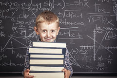 School boy and blackboard Royalty Free Stock Image