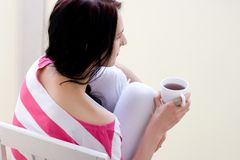 Caucasian young woman with cup of tea Royalty Free Stock Photos