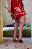 Caucasian young woman in red robe kimono for Valentines Day. Valentines Day surprise for that special some one. red floral pattern dress Stock Photos