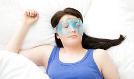 Caucasian young woman sleeping with an eye mask Royalty Free Stock Photos