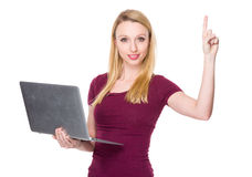 Caucasian young woman use of the laptop and finger point up Royalty Free Stock Photo