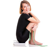 Caucasian young woman weight scale isolated white Royalty Free Stock Photography