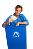 Caucasion Male With Recycle Bin Holding Money Stock Photos