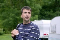 Caucassian man relaxed on camping meadow. Caucassian man relaxed on the tent camping meadow Royalty Free Stock Photo