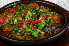 Caucasuan cuisine - ajapsandali. With eggplant, pepper, tomato and herbs Royalty Free Stock Photo